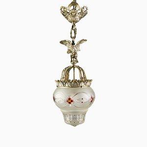 Lámpara colgante estilo neoclásico de bronce y cristal de hielo con águila, años 20