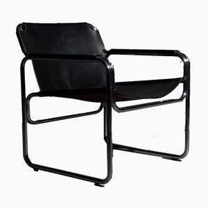 Silla Tube con asiento y reposabrazos de cuero Saddle en negro, años 60
