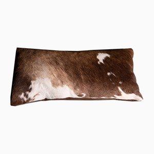 Cojín cubierto de cuero de vaca