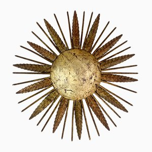 Lámpara española con forma de sol de metal forjado, años 50