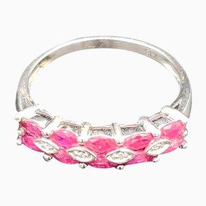 Anello vintage Half Eternity color rubino e diamanti