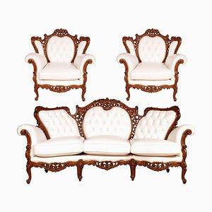 Set di poltrone e divano Rococò in legno di noce intagliato a mano e pelle di Bovolone, Italia, anni '30