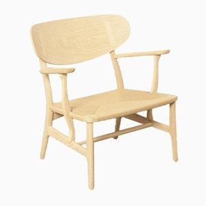 Contemporary Re-Edition CH22 Beistellstuhl von Hans J. Wegner für Carl Hansen & Søn