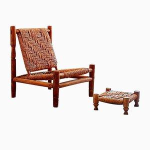Juego de sillón y reposapiés de madera y cuerda, años 60
