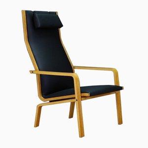 Poltrona modello 4335 Mid-Century in frassino ed ecopelle di Arne Jacobsen per Fritz Hansen, Danimarca, anni '60