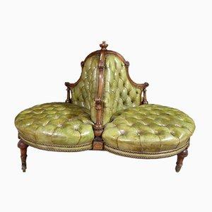 Seduta in noce e pelle verde