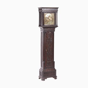 Antique Carved Oak Longcase Clock with Brass Face from Hugh Lough of Penrith