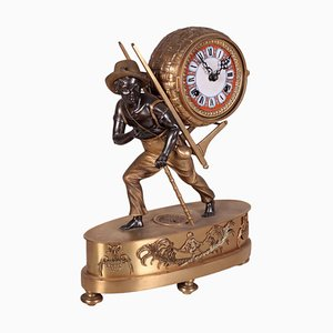 Vintage Table Clock with Dark-Haired Kid in Bronze and Iron