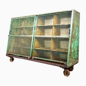 Industrial Weathered Steel Cabinet with Sliding Doors and Castors, 1950s