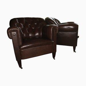 Club chair in pelle marrone scura, anni '20