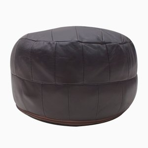Vintage Swiss Black Leather Ottoman, 1960s