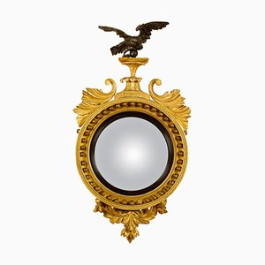 Early-19th Century Regency Round Gilt and Ebonized Wood Regal Convex Wall Mirror