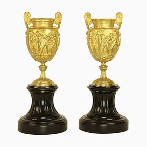 French Charles X Neoclassical Bacchanal Gilt Bronze & Black Marble Urns, Set of 2