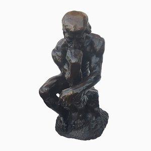 Escultura de pensador antiguo de bronce