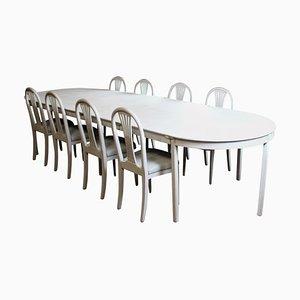 Juego de mesa y sillas de comedor Gustavian pintado en gris. Juego de 9