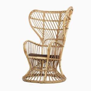 Großer Rattan Lounge Stuhl von Lio Carminati, 1950er