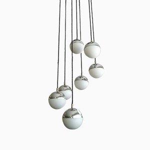 Lámpara colgante italiana esférica de vidrio opalino de Stilnovo, años 60