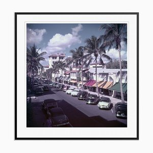 Palm Beach Street Oversize C Print Framed in Black by Slim Aarons