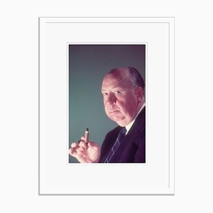 Alfred Hitchcock Holding A Cigar Framed in White by Baron