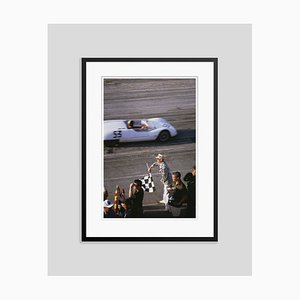 Checkered Flag Oversize C Print Framed in Black by Slim Aarons