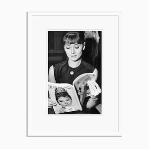 Audrey Reading Audrey Archival Pigment Print Framed in White by Everett Collection