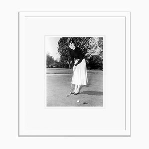 Audrey Hepburn Playing a Spot of Golf Archival Pigment Print Framed in White by Everett Collection
