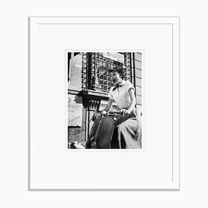 Audrey Hepburn on a Motorscooter Archival Pigment Print Framed in White by Bettmann