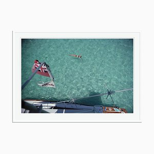 Swimming in Bermuda Oversize C Print Framed in White by Slim Aarons
