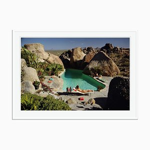 Sunbathing in Arizona Oversize C Print Framed in White by Slim Aarons