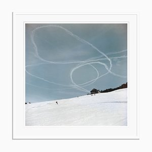 Skiing in Gstaad Oversize Archival Pigment Print Framed in Black by Slim Aarons