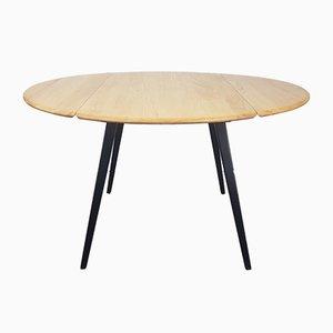 Ausziehbarer Esstisch mit schwarzem Tischbein von Lucian Ercolani für Ercol, 1960er