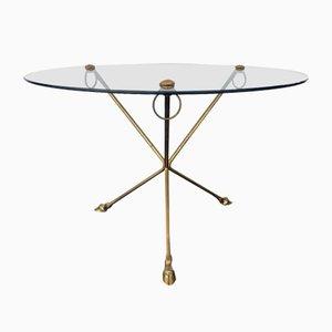 Mesa de centro de vidrio y latón con patas trípode en forma de pezuñas, años 70