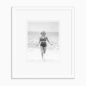Betty Grable Chasing Waves Archival Pigment Print Framed in White by Everett Collection