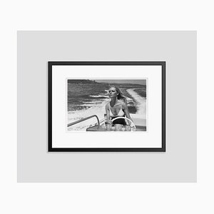 Bardot Boat Trip Archival Pigment Print Framed in Black by Jean-Pierre Bonnotte