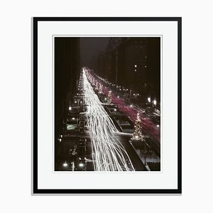 Christmas Traffic Oversize Archival Pigment Print Framed in Black by Slim Aarons