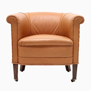Club chair in pelle marrone con rotelle, anni '30