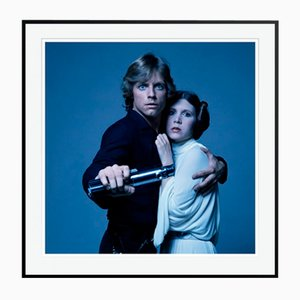 Luke and Leia by Terry O'Neill Framed in Black by Terry O'Neill