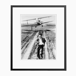 Cary Grant Plane Action Archival Pigment Print Framed in Black by Everett Collection