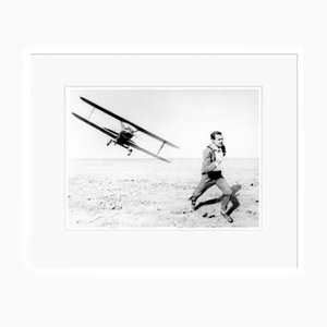 Cary Grant in Action Archival Pigment Print Framed in White by Everett Collection