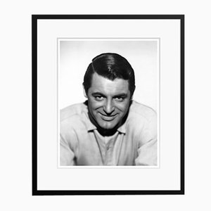 Cary Grant Grins at the Camera Archival Pigment Print Framed in Black by Everett Collection