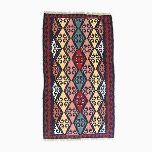 Türkischer Vintage Kelim-Teppich aus Rot, Blau, Rosa & Schwarzer Wolle, 1960er