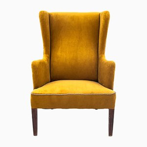 Yellow Wingback Armchair, 1950s
