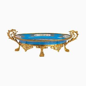 Antike Tasse aus Sèvres Porzellan und vergoldeter Bronze