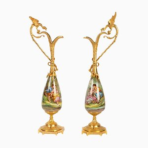 Gilt Bronze and Porcelain Ewers Topped with a Winged Dragon, Set of 2