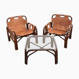 Mesa y butacas italianas de cuero y bambú de Tito Agnoli, años 60. Juego de 3