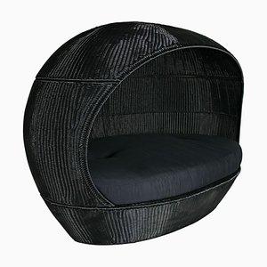 Divano Nettuno da esterno nero intrecciato in PLT con cuscino nero di Vgnewtrend