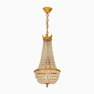 Lámpara de araña estilo Imperio de latón cincelado, años 50