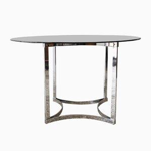 Mesa de comedor de vidrio y cromo de Merrow Associates, años 70