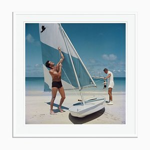 Boating in Antigua Oversize C Print Framed in White by Slim Aarons