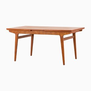 Danish Teak Extendable Dining Table with Concealed Panels in the Style of Johannes Andersen, 1960s